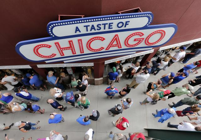 Fans line up for food during an Arizona Diamondbacks against the Chicago Cubs spring training baseball game on Thursday, Feb. 27, 2014, in Mesa, Ariz. It was the Cubs' first Cactus League game in their new spring training facility. (AP Photo/Matt York)