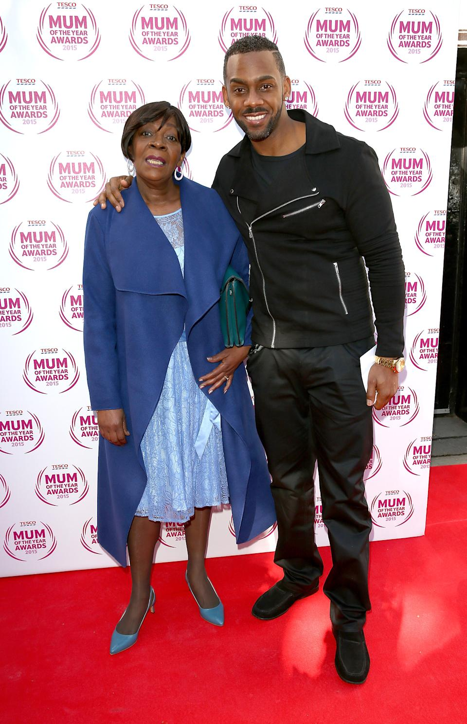 LONDON, ENGLAND - MARCH 01:  Richard Blackwood (R) and his mother attend the Tesco Mum of the Year Awards at The Savoy Hotel on March 1, 2015 in London, England.  (Photo by Tim Whitby/Getty Images)