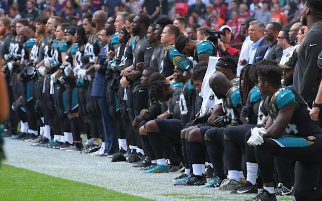 Members of the Jaguars protest prior to their game with the Ravens. (AP)