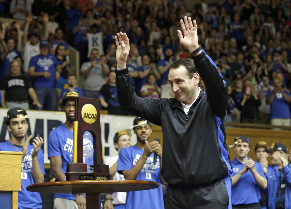 Mike Krzyzewski reacts as the Duke basketball team is welcomed at Cameron Indoor Stadium after their title win. (AP)