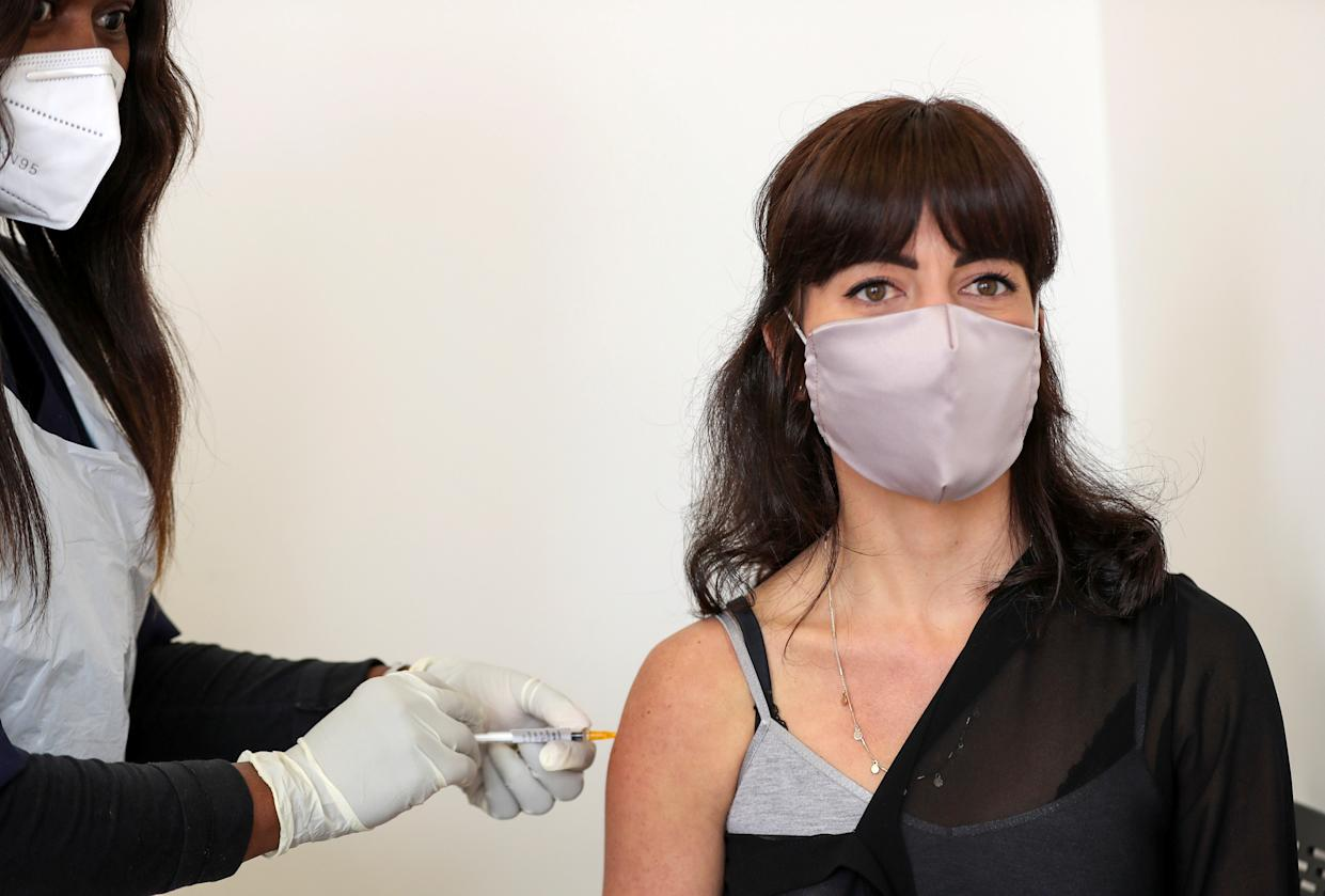 Robyn Porteous, a vaccine trials' volunteer, is injected with a vaccine