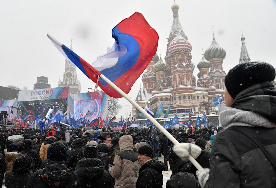 A man holds a national flag during the 'Russia is in my heart!' rally in support of Russian athletes on February 3, 2018 in central Moscow. The IOC's disciplinary commission banned 43 Russian athletes for life and disqualified Russia from competing at the Pyeongchang Games over the doping conspiracy. Following an appeal by 42 athletes, CAS cleared 28 citing insufficient evidence against them and also lifted the life ban on 11 others, but barred them from taking part in the 2018 Olympics. / AFP PHOTO / Vasily MAXIMOV        (Photo credit should read VASILY MAXIMOV/AFP/Getty Images)