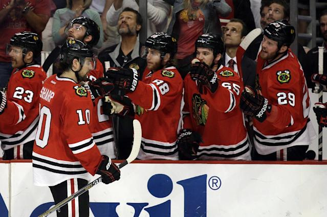 Chicago Blackhawks left wing Patrick Sharp (10) celebrates his goal against Los Angeles Kings with his teammates during the first period in Game 7 of the Western Conference finals in the NHL hockey Stanley Cup playoffs Sunday, June 1, 2014, in Chicago. (AP Photo/Nam Y. Huh)