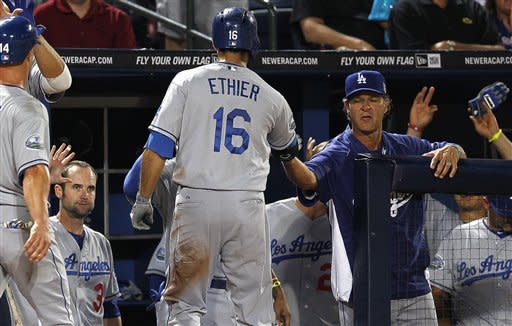 Los Angeles Dodgers' Andre Ethier (16) is greeted at the dugout after hitting a two-run home run in the sixth inning of a baseball game against the Atlanta Braves, Friday, Aug. 17, 2012, in Atlanta. (AP PhotoJohn Bazemore)