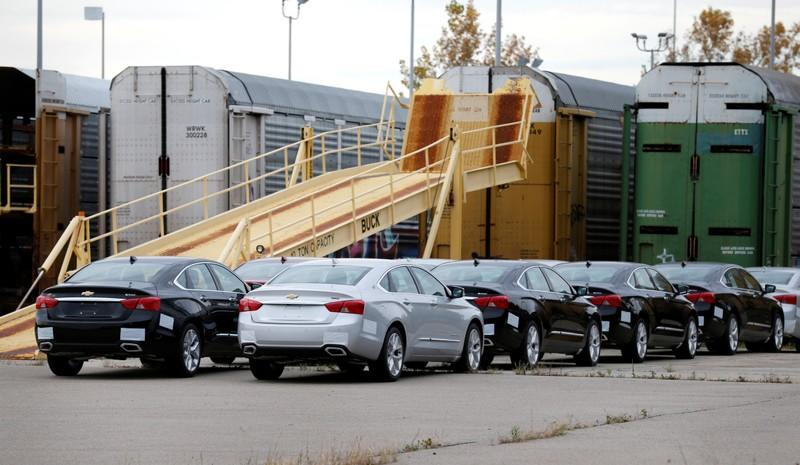 Chevrolet 2019 Impala vehicles sit outside waiting to be loaded on to transport trains outside the General Motors Detroit-Hamtramck Assembly in Hamtramck