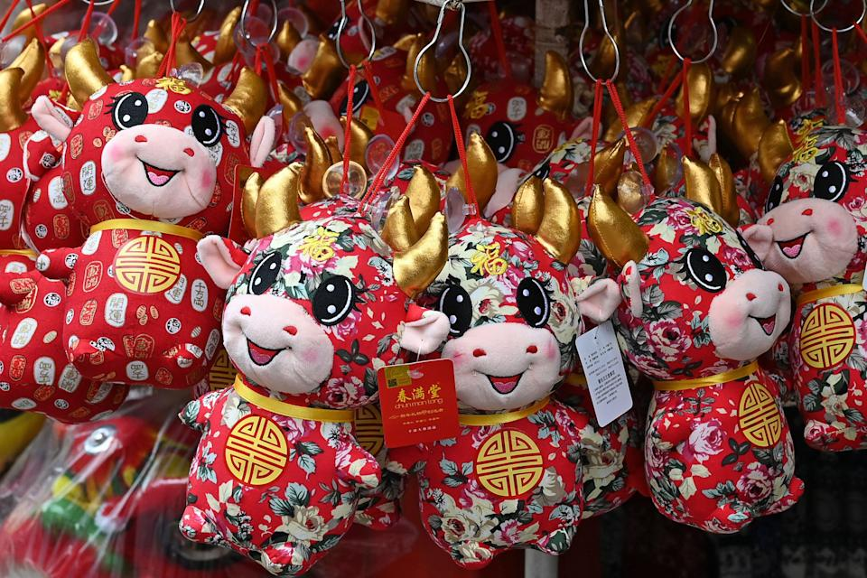 A shop display stuffed toys related to the Chinese zodiac sign of the Ox ahead of the Lunar New Year in the Chinatown area of Singapore on January 25, 2021. (Photo by ROSLAN RAHMAN / AFP) (Photo by ROSLAN RAHMAN/AFP via Getty Images)
