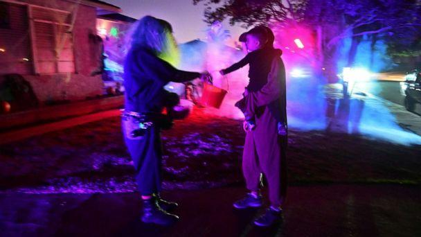 PHOTO: A child receives candy while trick or treating on Halloween night in Monterey Park, Calif., Oct. 31, 2019. (Frederic J. Brown/AFP via Getty Images, FILE)