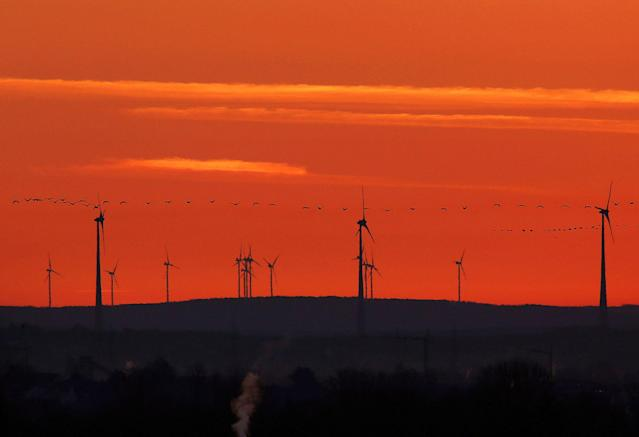 "<p>A flock of birds flies past wind turbines just before sunrise in the outskirts of Frankfurt, Germany on March 28, 2017. A senior EU official says Wednesday, May 31, 2017, the EU and China will reaffirm their commitment to the Paris climate change accord this week, regardless of whether President Donald Trump pulls out of the pact. The official told reporters that the EU and China will also ""spell out"" how they plan to meet their commitments to the accord at talks in Brussels on Friday. (AP Photo/Michael Probst) </p>"