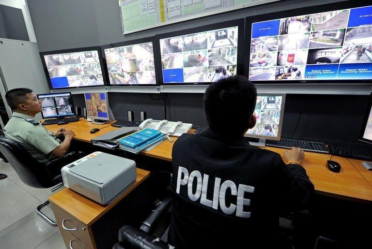 Security officers in Bangkok monotor CCTV cameras on July 2, 2010