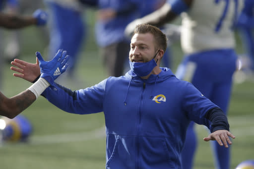 Los Angeles Rams head coach Sean McVay greets players before an NFL wild-card playoff football game against the Seattle Seahawks, Saturday, Jan. 9, 2021, in Seattle. (AP Photo/Scott Eklund)