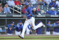 Iowa Cubs shortstop Addison Russell scores a run during a Triple-A baseball game against the Nashville Sounds, Wednesday, April 24, 2019, in Des Moines, Iowa. Russell played in his first game of the season Wednesday for Iowa as he prepares to return to the Chicago Cubs following his domestic violence suspension. (AP Photo/Charlie Neibergall)