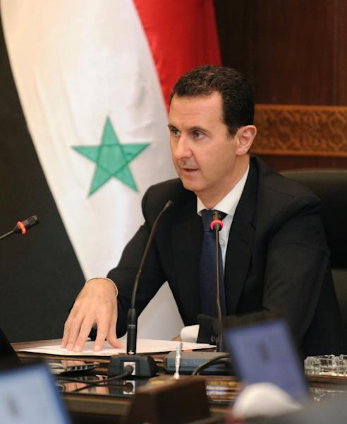 Syrian President Bashar al-Assad, backed by his ally Russia, has strongly denied the allegation that his forces used chemical weapons against the rebel-held town of Khan Sheikhun (AFP Photo/SANA)