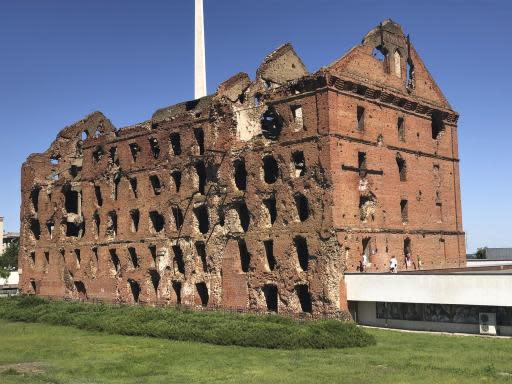 This photo taken on Sunday, June 17, 2018, shows the Panorama Museum in Volgograd, built next to the gutted remains of a ruined mill. Nearly 60 years since it changed its name to Volgograd, the Russian city once called Stalingrad and its bloody history loom large even in the midst of the fun and football of the World Cup. (AP Photo/Panagiotis Pylas)