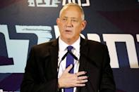 Benny Gantz, leader of Blue and White, gestures as he delivers a statement before his party faction meeting in Tel Aviv, Israel