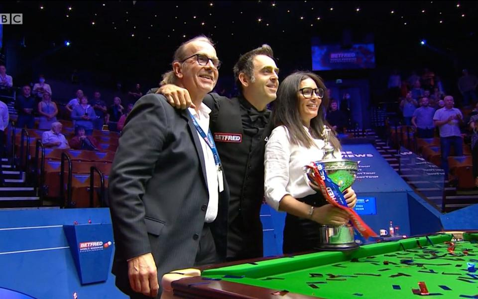 Ronnie O'Sullivan (centre) with the Betfred World Snooker Championship trophy - BBC