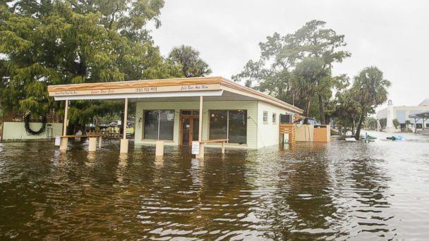 PHOTO: The Cooter Stew Cafe starts taking water in the town of Saint Marks as Hurricane Michael pushes the storm surge up the Wakulla and Saint Marks Rivers which come together here on Oct. 10, 2018, in Saint Marks, FLa. (Mark Wallheiser/Getty Images)