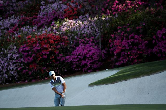 Rickie Fowler of the U.S. chips onto the 13th green during first round play of the 2018 Masters golf tournament at the Augusta National Golf Club in Augusta, Georgia, U.S., April 5, 2018. REUTERS/Mike Segar TPX IMAGES OF THE DAY