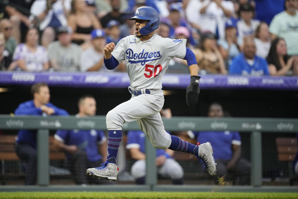 Los Angeles Dodgers' Mookie Betts heads home to score on a Max Muncy single off Colorado Rockies starting pitcher Kyle Freeland during the sixth inning of a baseball game Saturday, July 17, 2021, in Denver. (AP Photo/David Zalubowski)