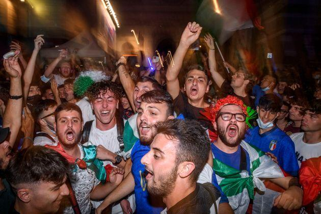 ROME, ITALY - JULY 02: Italian fans celebrate the victory of Italy at Piazza del Popolo fan zone after the Euro 2020 Quarter Final match between Belgium and Italy played at Fussball Arena Muenchen, on July 2, 2021 in Rome, Italy. The winner of this match heads to the UEFA European Football Championship's semi-final match. The tournament was postponed from last year due to the Covid-19 pandemic. (Photo by Antonio Masiello/Getty Images) (Photo: Antonio Masiello via Getty Images)