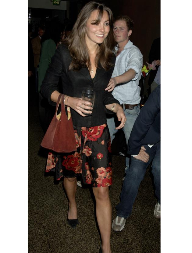 Kate Middleton photos: This skirt isn't deserving of the duchess's attention but she wore it regardless with a fitted black jacket. We're happy to see how here accessories have changed over the years.