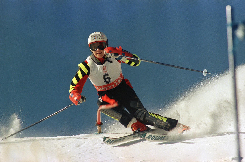 FILE - In this Friday, Feb. 26, 1988 file photo, Spanish skier Blanca Fernandez Ochoa speeds down the slope during the first run for the Olympic slalom competition, at Mt. Allan in Nakiska, Alberta. A search squad of hundreds is combing a mountainous area outside Madrid 10 days after former alpine ski racer and Olympic medalist Blanca Fernandez Ochoa went missing. Spain's National Police said Fernandez was last spotted on surveillance video at a shopping center on Aug. 24, 2019. (AP Photo/Dieter Endlicher, File)
