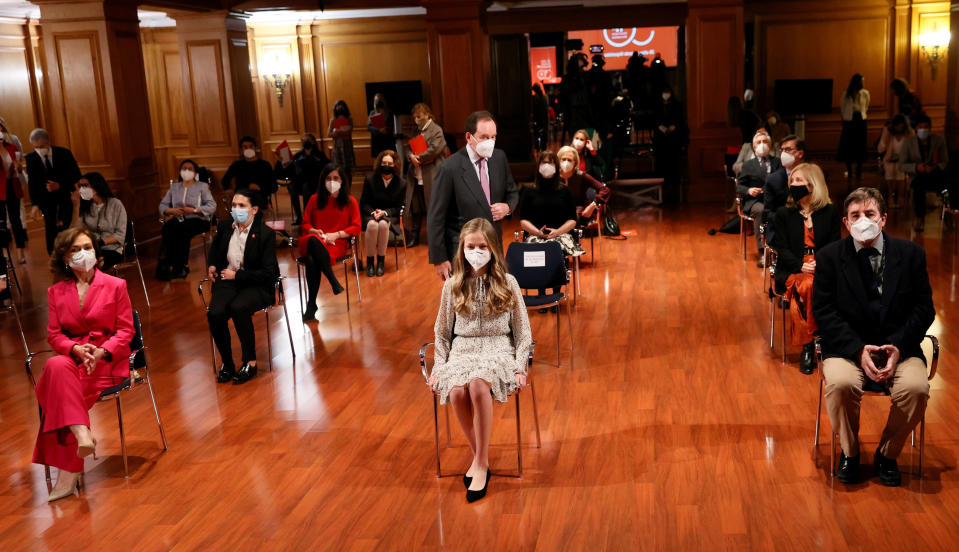 Spain's Princess Leonor, center, sits with Spain's Deputy Prime Minister Carmen Calvo, left, and the Director of the Cervantes Institute, Luis Garcia Montero during an event to commemorate the 30th anniversary of the Cervantes Institute in Madrid, Spain, Wednesday March 24, 2021. This is the first time Princess Leonor has presided an official event alone without the presence of her father, King Felipe VI. (Ballesteros/Pool photo via AP)