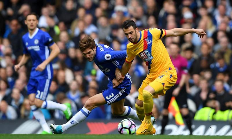 Crystal Palace's Luka Milivojevic blocking a challenge from Marcos Alonso of Chelsea during Palace's 2-1 win
