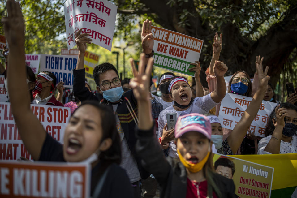 FILE - In this March 3, 2021 file photo, Chin refugees from Myanmar shout slogans during a protest against military coup in Myanmar, in New Delhi, India. Four Indian states bordering Myanmar have stepped up measures to prevent refugees from entering India through a porous border following last month's military coup in the Southeast Asian country, a government official said Saturday. (AP Photo/Altaf Qadri)