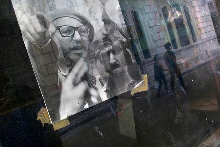 A picture of Fidel Castro is seen on the window of a local shop, following the announcement of the death of the Cuban revolutionary leader, in Havana, Cuba November 27, 2016. REUTERS/Carlos Barria