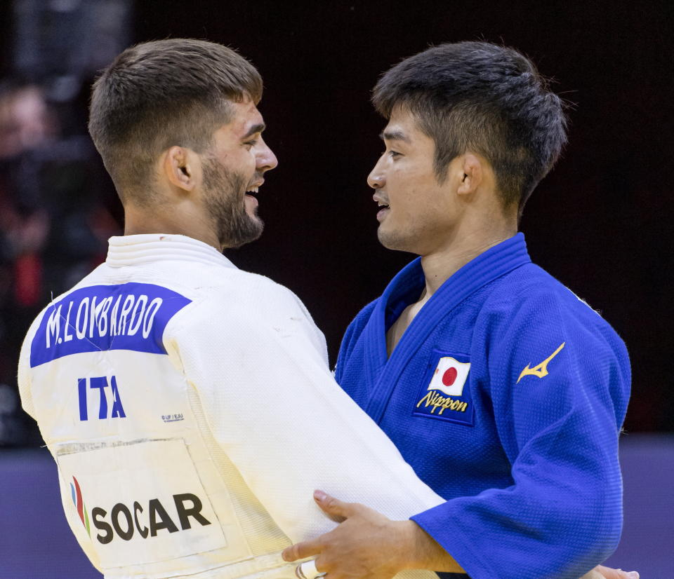 Manuel Lombardo of Italy and Joshiro Maruyama of Japan embrace after their fight in the final of men's 66kg category at the World Judo Championships in Budapest, Hungary, in this Monday, June 7, 2021, file photo. Judo is coming home at the Tokyo Olympics, and the Japanese team is under a world of pressure. Fortunately for the host nation, this powerhouse group of athletes is eager to rise to the momentousness of this moment in their sport, which was born in Japan and introduced to the Olympics at the previous Tokyo Games 57 years ago. (Zsolt Szigetvary/MTI via AP, File)
