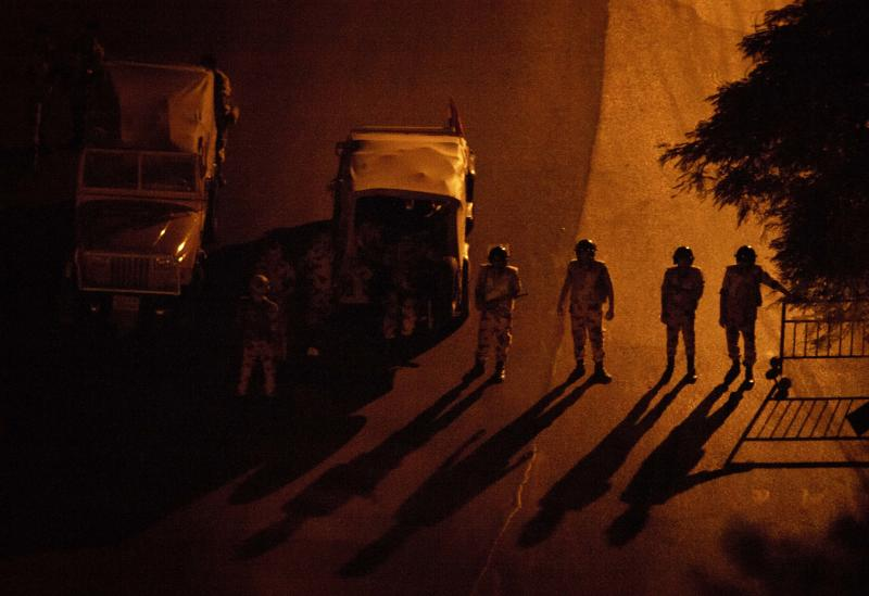 Egyptian soldiers stand guard at a checkpoint during a dawn-to-dusk curfew in the Zamalek district of Cairo, Egypt, Tuesday, Aug. 20, 2013. Elsewhere, an Egyptian journalist working for a state-run daily was shot dead early Tuesday by soldiers at a military checkpoint, security officials said. Tamer Abdel-Raouf from Al-Ahram and a colleague were on the road after finishing a late-night interview with the recently appointed governor of Beheira province in the Nile Delta north of Cairo. (AP Photo/Maya Alleruzzo)