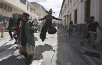 """Revelers dance during the """"Inti Raymi,"""" or Sun Festival celebrations, despite restrictions to prevent the spread of the coronavirus, in Cotacachi, Ecuador, Thursday, June 24, 2021. Across the Andes, from the tip of Argentina as far north as Colombia, indigenous communities gather in June for the southern hemisphere's winter solstice to pay homage to Inti, the ancient Incan sun god, in hopes of being granted a plentiful harvest. (AP Photo/Dolores Ochoa)"""