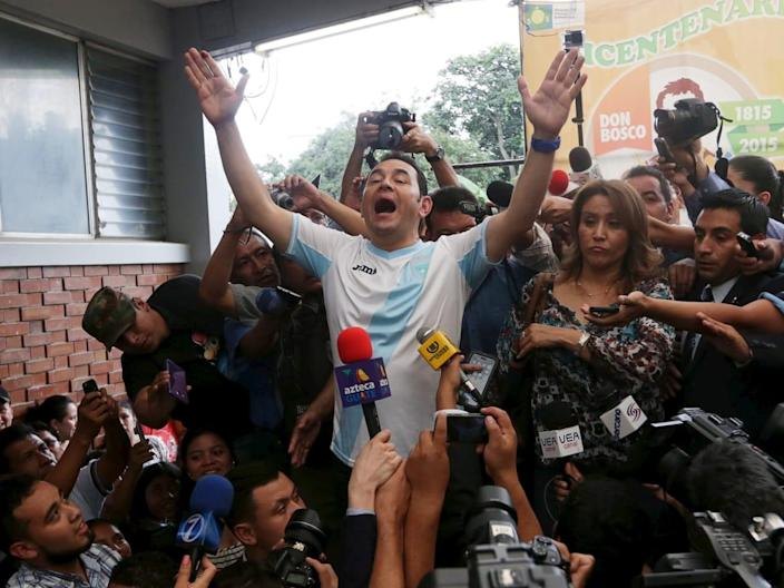 """<div class=""""inline-image__caption""""> <p>""""Jimmy Morales (C), presidential candidate for the National Convergence Front party (FCN), gestures while addressing the media next to his wife Gilda Marroquin (R) after casting his vote at a polling station in Guatemala City, October 25, 2015. A former TV comedian with no experience in government is poised to win Guatemala's presidential election on Sunday after a corruption scandal toppled the country's last leader and fueled voter outrage with the political establishment. Playing up his outsider status and promising clean government, 46-year-old Jimmy Morales has surged in opinion polls since a probe into a multi-million dollar customs racket led to the resignation and arrest of President Otto Perez. Voter surveys show Morales is set to easily win Sunday's run-off vote against former first lady Sandra Torres, who also vows to tackle corruption but is seen by many voters as part of the old political order. REUTERS/Jorge Dan Lopez TPX IMAGES OF THE DAY""""</p> </div> <div class=""""inline-image__credit""""> REUTERS </div>"""