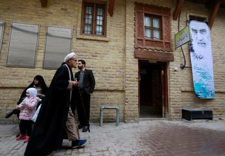 Iranian pilgrims are seen outside the former home of the late Ayatollah Ruhollah Khomeini, in Najaf, Iraq February 10, 2019. REUTERS/Alaa al-Marjani