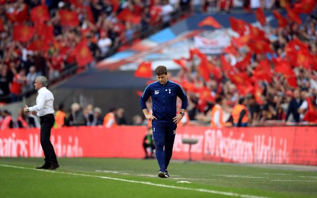 "Mauricio Pochettino has hinted that he may not stay around to deliver Tottenham Hotspur their first trophy in a decade after losing to Manchester United at Wembley, the second consecutive FA Cup semi-final defeat from a winning position in two years. Dele Alli gave Spurs the lead within ten minutes but they were beaten by goals in either half from Alexis Sanchez and Ander Herrera, prompting Pochettino to hint at his own future saying that ""to create that [success] doesn't take a few years, Tottenham needs more time - with me or another [manager]."" Pochettino, contracted until 2021, had earlier made the same point to broadcaster beIN Sports saying: ""To compete in this type of game, I think we are ready to compete - but win is different. The most important [thing] is that we are in this process, that after four years we can compete and that is fantastic. ""But the disappointment and frustration is that we are close but we cannot reach. I told your colleague before that with me or another coaching staff the club needs to push on, working in this direction and will be fantastic one day for Tottenham to reach the same level as the clubs like Manchester United and Manchester City. But a long way to work to arrive at this next level."" Heartache 