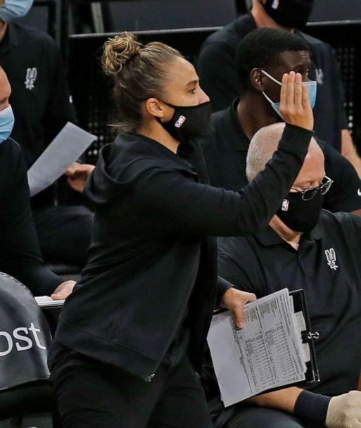 PHOTO: Assistant coach Becky Hammon of the San Antonio Spurs takes over head coaching duties after Gregg Popovich was ejected, Dec. 30, 2020 in San Antonio, Texas. (Ronald Cortes/Getty Images)