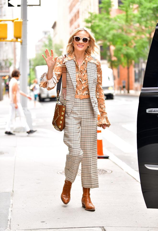 <p>Diana Kruger attended a press event wearing a plaid vest and trouser set with a '70s blouse underneath.  </p>