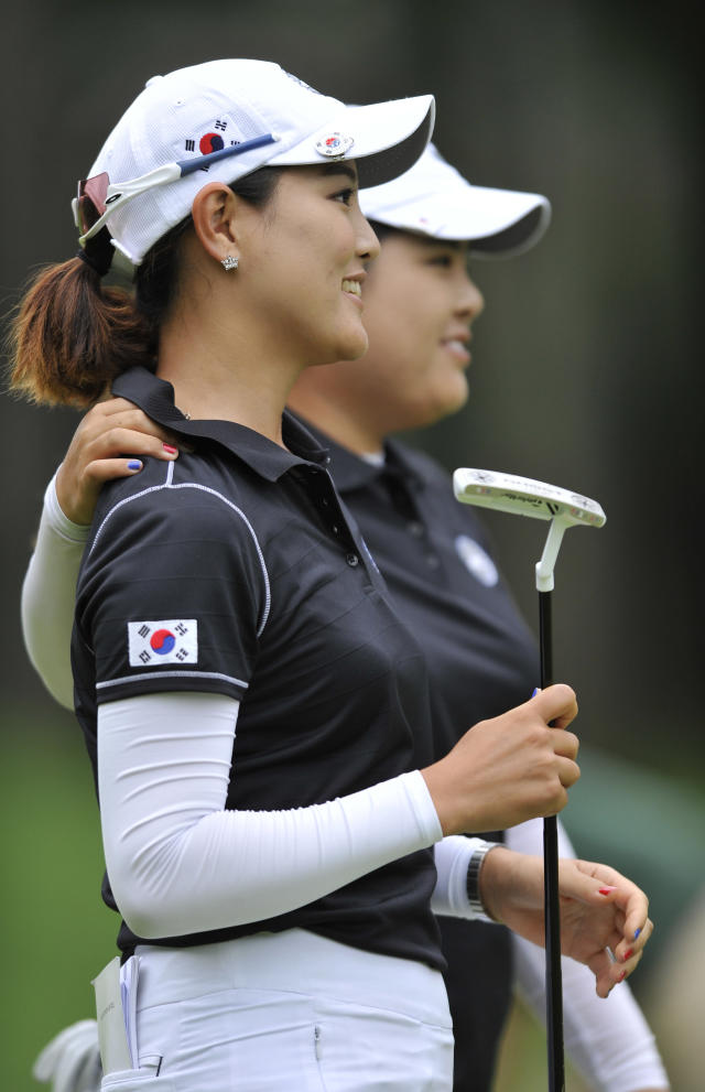 Inbee Park, right, and So Yeon Ryu, of South Korea, walk to the third hole after putting on the second hole during the first round of the International Crown LPGA golf tournament Thursday, July 24, 2014, in Baltimore.(AP Photo/Gail Burton)