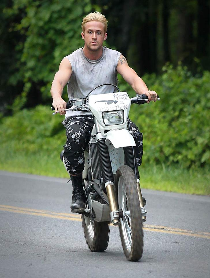 "After bleaching his hair and getting a temporary tattoo for his latest role in ""The Place Beyond the Pines,"" Ryan Gosling wanted to prove that blonds really do have more fun. The 30-year-old actor jumped on a motorbike and cruised around the set in Upstate New York on Wednesday. StClair/Massie/<a href=""http://www.splashnewsonline.com"" target=""new"">Splash News</a> - July 27, 2011"