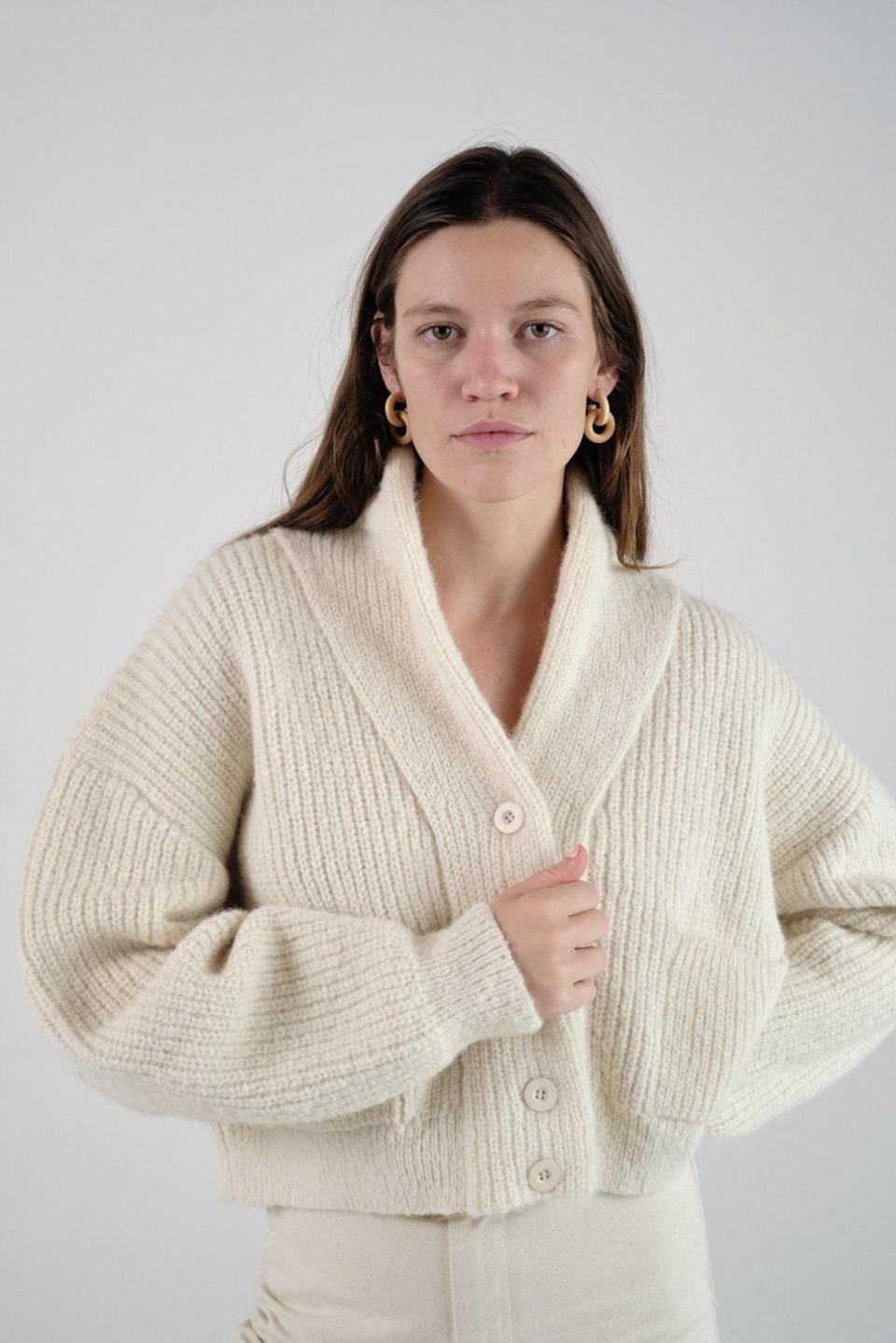 """Get ready to envelop yourself in every inch of this cashmere sweater, featuring drop shoulders and a shawl collar that's practically made for snuggling. $298, Ozma of California. <a href=""""https://ozmaofcalifornia.com/products/sloan-cardigan-caravelli-cream"""" rel=""""nofollow noopener"""" target=""""_blank"""" data-ylk=""""slk:Get it now!"""" class=""""link rapid-noclick-resp"""">Get it now!</a>"""
