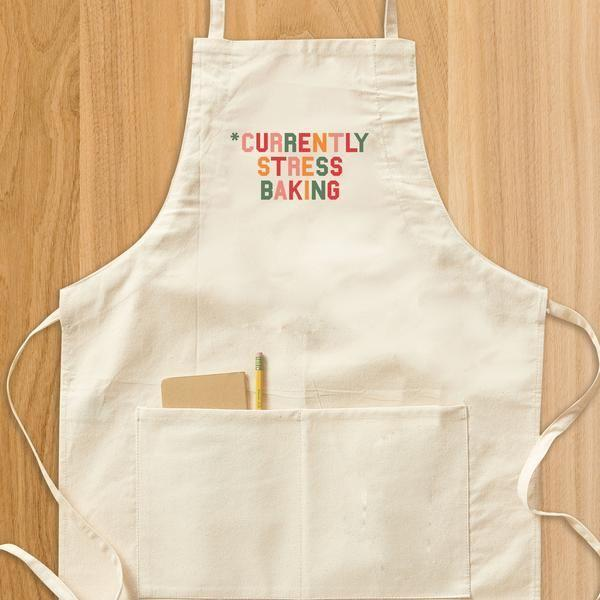 """<p>delish.com</p><p><strong>$25.00</strong></p><p><a href=""""https://shop.delish.com/products/currently-stress-baking-apron"""" rel=""""nofollow noopener"""" target=""""_blank"""" data-ylk=""""slk:BUY NOW"""" class=""""link rapid-noclick-resp"""">BUY NOW</a></p><p>This apron is so popular, it's already sold out five times. </p><p><strong>See more on <a href=""""https://shop.delish.com/"""" rel=""""nofollow noopener"""" target=""""_blank"""" data-ylk=""""slk:shop.delish.com"""" class=""""link rapid-noclick-resp"""">shop.delish.com</a>. </strong></p>"""