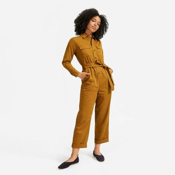 """A jumpsuit that's ready for work <em>and</em> play. $100, Everlane. <a href=""""https://www.everlane.com/products/womens-modern-utility-jumpsuit-brass?collection=dresses"""">Get it now!</a>"""