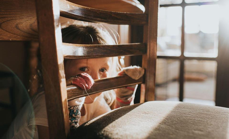 """<p>A lot of parents, teachers, and caregivers write off a child's refusal in certain situations as timidness. But this is actually called selective mutism, and it's a form of anxiety.</p><p> According to the <a href=""""https://adaa.org/living-with-anxiety/children/childhood-anxiety-disorders"""" rel=""""nofollow noopener"""" target=""""_blank"""" data-ylk=""""slk:ADAA"""" class=""""link rapid-noclick-resp"""">ADAA</a>, kids who have selective mutism may be motionless and expressionless, turn their heads, chew or twirl their hair, avoid eye contact, or withdraw into a corner. With selective mutism, you might notice that they are totally fine, talkative, and social in certain places, mostly places where they're comfortable, like their home. <br></p>"""