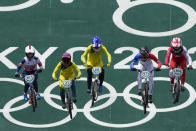 From left, Bethany Shriever of Britain, Lauren Reynolds of Australia, Saya Sakakibara of Australia, Manon Valentino of France, and Zoe Claessens of Switzerland compete in the women's BMX Racing quarterfinals at the 2020 Summer Olympics, Thursday, July 29, 2021, in Tokyo, Japan. (AP Photo/Ben Curtis)