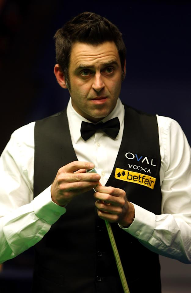 SHEFFIELD, ENGLAND - MAY 04:  Ronnie O'Sullivan of England in action against Judd Trump of England during the Semi Final match of the Betfair World Snooker Championship at the Crucible Theatre on May 4, 2013 in Sheffield, England.  (Photo by Warren Little/Getty Images)