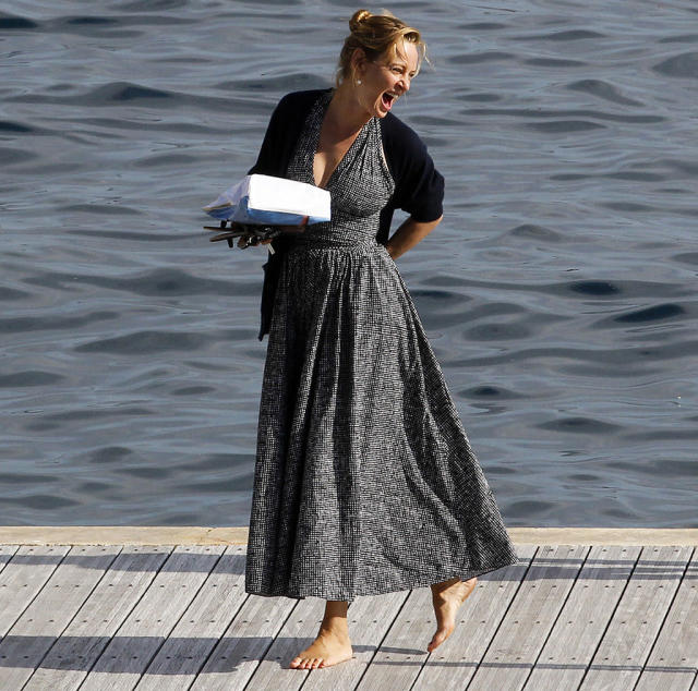 <p>The actress looked carefree as can be as she walked barefoot and laughing on the docks at Hotel du Cap-Eden-Roc. (Photo: Splash News) </p>