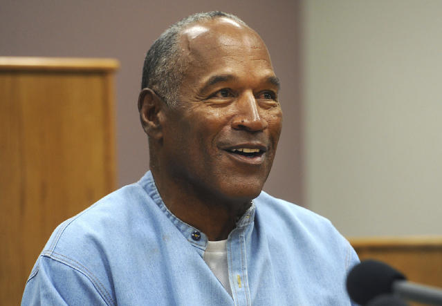 FILE - In this July 20, 2017 file photo, former NFL football star O.J. Simpson appears via video for his parole hearing at the Lovelock Correctional Center in Lovelock, Nev. A Las Vegas Strip hotel-casino is denying that Simpson was defamed when employees banned him from the property in November 2017 and a celebrity news site reported the paroled former football hero had been drunk, disruptive and unruly. In recent court filings, the Cosmopolitan of Las Vegas rejects Simpson's argument that his reputation was damaged by unnamed hotel staff member accounts cited in a TMZ report saying he was prohibited from returning after visits to a steakhouse and cocktail lounge. (Jason Bean/The Reno Gazette-Journal via AP, Pool)