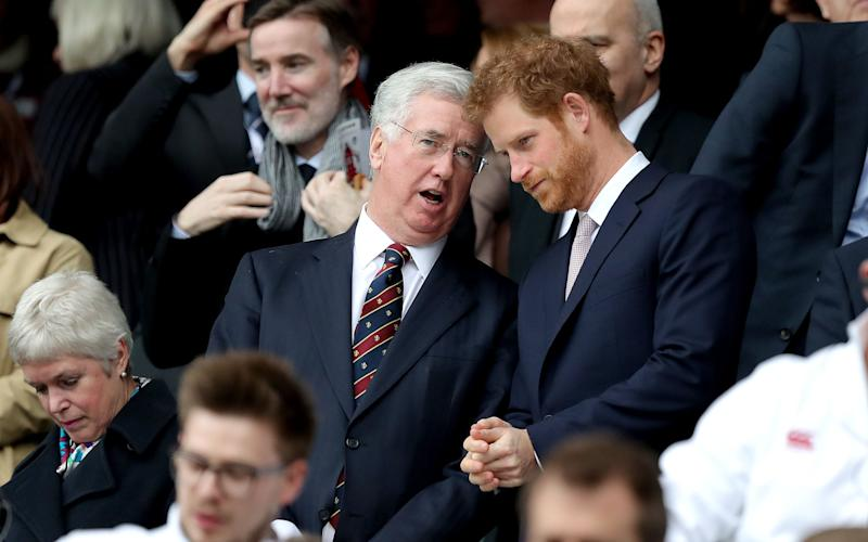 Prince Harry is deep in conversation with Sir Michael Fallon, the defence secretary - Credit: Andrew Matthews/PA