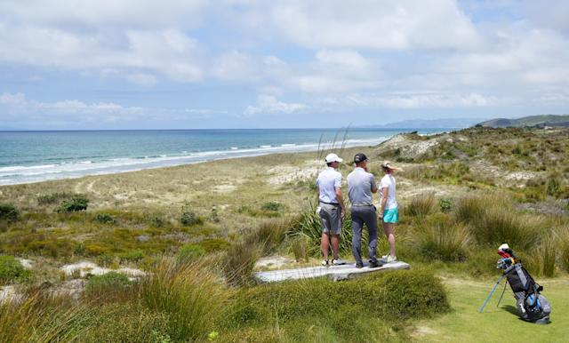 "<div class=""caption""> Jim Rohrstaff ( <em>left</em>), who works closely with Kayne on selecting the membership at Tara Iti and crafting its vibe, along with David McKlay Kidd ( <em>center</em>) and his wife, Tara. The three of them are taking a look at land that lies just south of Tara Iti's golf course </div>"