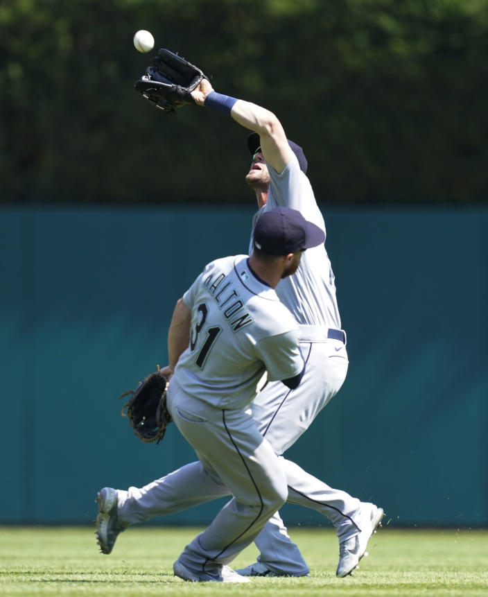 Seattle Mariners second baseman Donovan Walton (31) allows right fielder Mitch Haniger to catch the fly out hit by Detroit Tigers' Willi Castro during the seventh inning of a baseball game, Thursday, June 10, 2021, in Detroit. (AP Photo/Carlos Osorio)